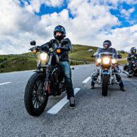 three motorcyclists driving beautiful road