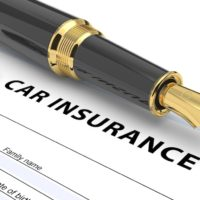 Pen and animated car on top of car insurance form
