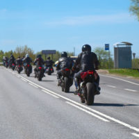 group of motorcyclists riding together