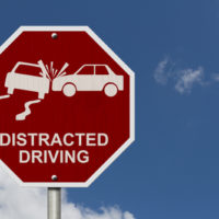 Sign that reads distracted driving.jpg.crdownload