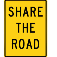 share the road black and yellow road sign