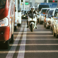 Motorcycle lane splitting in busy traffic