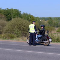 Motorcycle rider talking with cop
