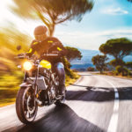 guy riding motorcycle.jpg.crdownload