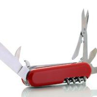 red pocket knife unfolded