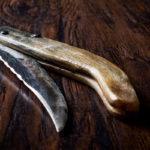 Handmade Wooden Pocket Knife on Dark Surface.