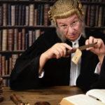 judge holding Knife