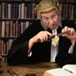 Judge holding knife in court